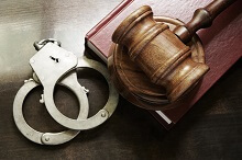 Gavel and handcuffs